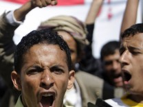 Students in Sanaa shout slogans during a demonstration in support of the ousting of Tunisia's President Ben Ali