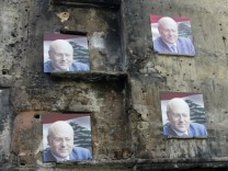 Electoral campaign posters of former Lebanese prime minister and parliamentary candidate Najib Mikati are seen on a building in a street in Tripoli