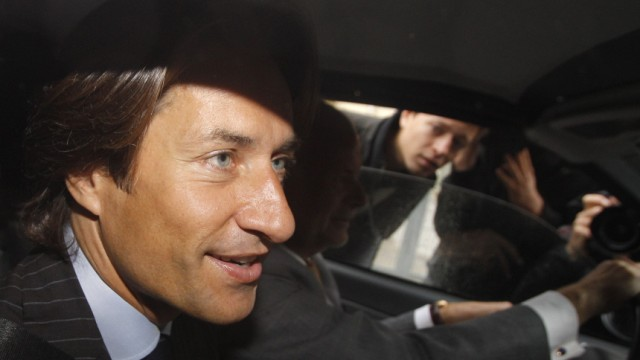 Austrian former Finance Minister Grasser sits in a car as he arrives to be questioned by the Anti-Corruption Authority in Vienna