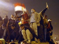 Egypt under curfew as protests continue
