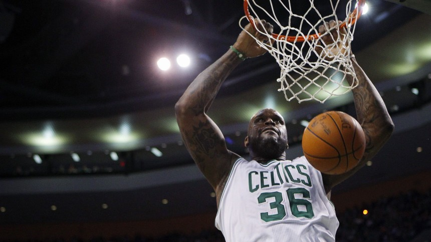 Boston Celtics center Shaquille O'Neal dunks the ball against the Detroit Pistons in the second quarter of their NBA basketball game in Boston