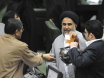 A member of parliament casts his vote during the impeachment of Roads and Transport Minister Hamid Behbahani in Tehran