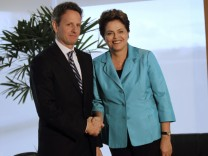 Brazil's President Dilma Rousseff poses with U.S. Treasury Secretary Timothy Geithner during a meeting in Brasilia