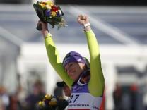 Riesch of Germany celebrates third place after her Super-G race at the Alpine Ski World Championship in Garmisch-Partenkirchen