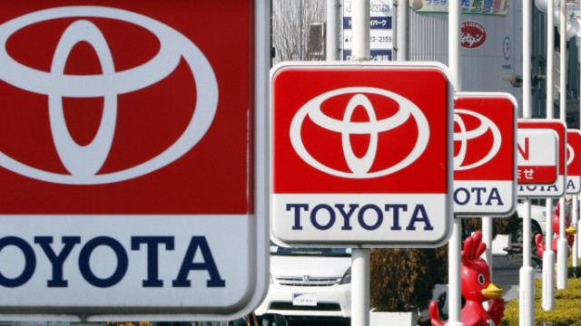 Toyota Motor signboards are displayed at a dealer's shop in Yokohama