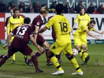 Borussia Dortmund's Sven Bender scores a goal during their German Bundesliga soccer match against 1.FC Kaiserslautern in Kaiserslautern