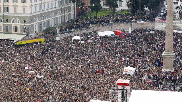 People gather in Rome's Piazza del Popolo to demonstrate against Italy's Prime Minister Silvio Berlusconi