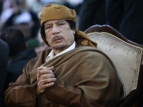 Libyan leader Muammar Gaddafi attends a ceremony marking the birth of Islam's Prophet Mohammed in Tripoli