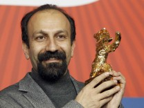 Iranian director Asghar Farhadi poses with Golden Bear award at 61st Berlinale International Film Festival in Berlin