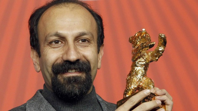 Iranian director Asghar Farhadi poses with Golden Bear award at 61st Berlinale International Film Festival in Berlin