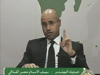 A video grab shows Saif al-Islam, son of Libyan leader Muammar Gaddafi, speaking during an address on state television in Tripoli