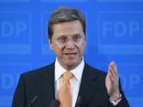 German Foreign Minister Westerwelle makes statement on crackdown of protests in Libya during news conference in Berlin