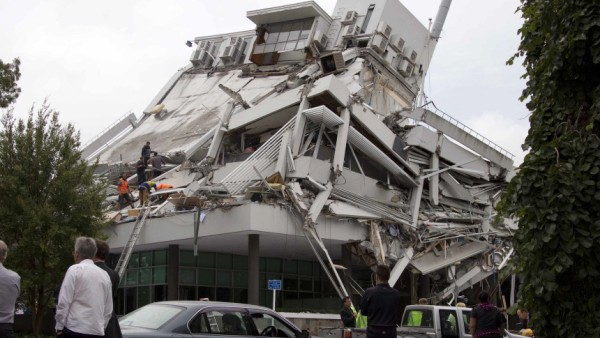Rescue crews look for staff in the damaged Pyne Gould Guinness building in central Christchurch
