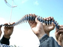 Libyan men hold up a chain of bullets in this undated picture