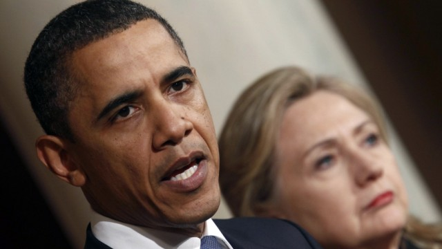 U.S. President Barack Obama speaks about Libya while U.S. Secretary of State Hillary Clinton listens in the White House in Washington