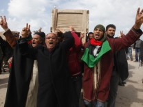 Mourners carry a coffin containing the body of a Libyan who was killed in the recent clashes in Benghazi