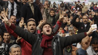Anti-Gaddafi protesters chant slogans during a protest in Benghazi