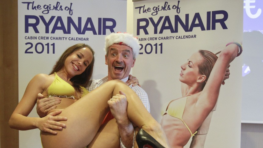 Ryanair chief executive O'Leary poses with stewardess to promote the Cabin Crew Charity Calendar in Berlin