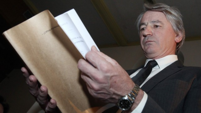 Former chief executive of nationalized bank Hypo Group Alpe Adria Wolfgang Kulterer waits for the start of his trial in Klagenfurt