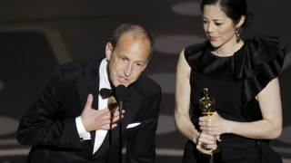 Charles Ferguson and Audrey Marrs accept the Oscar for best documentary feature during the 83rd Academy Awards in Hollywood