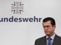 File photo of German Defence Minister Guttenberg addressing media in Berlin