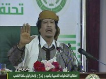 Image from video shows Libyan leader Gaddafi speaking at an event in Tripoli