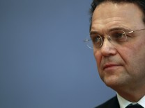 Germany's new Interior Minister Friedrich attends a news conference in Berlin