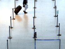 A passenger walks past empty counters at Nice International airport