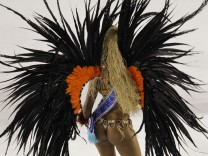 A reveler of the Uniao da Ilha samba school participates in the Carnival parade in Rio
