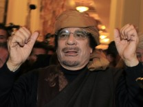 Libya's leader Muammar Gaddafi arrives to give television interviews at a hotel in Tripoli