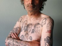 Miljenko Parserisas Bukovic displays some of his tattoos of U.S. actress Julia Roberts during a photo-shoot in Valparaiso city