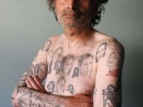 Miljenko Parserisas Bukovic displays some of his tattoos of U.S. actress Julia Roberts during a photo-shoot in Valparaiso city