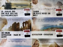 Combination photo shows advertising campaign posters for tourism in Egypt referring to political uprising in the country at ITB in Berlin