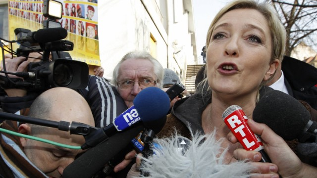 France's far-right National Front political party leader Marine Le Pen speaks to the media as she campaigns in Strasbourg