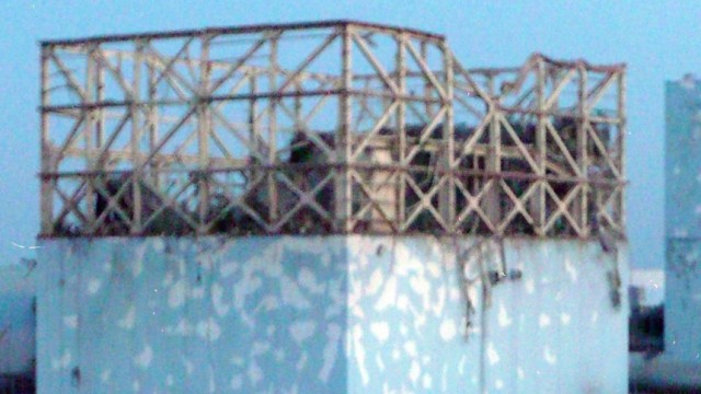 The damaged roof of reactor number No. 1 at the Fukushima Daiichi nuclear plant after an explosion is seen in this handout photo