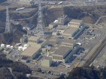 An aerial view of Onagawa Nuclear Power Plant after an earthquake and tsunami struck Miyagi Prefecture in northern Japan