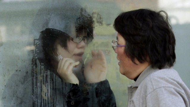 Mother tries to talk to her daughter who has been isolated for signs of radiation, in Nihonmatsu