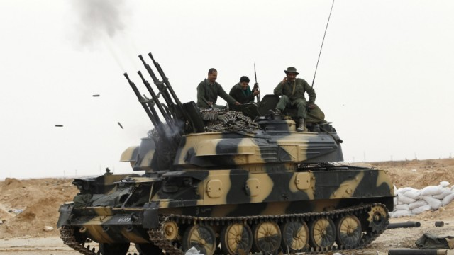 Libyan government soldiers test fire an armoured anti-aircraft gun at the west gate of town Ajdabiyah