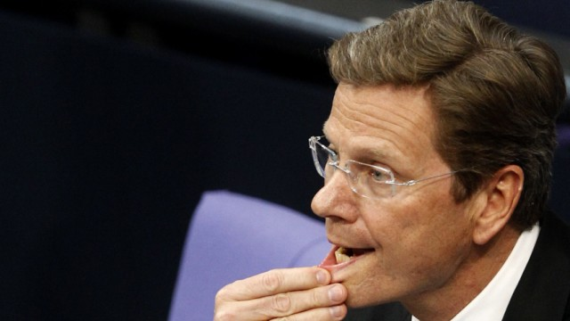 German Foreign Minister Westerwelle reacts during German Bundestag session in Berlin
