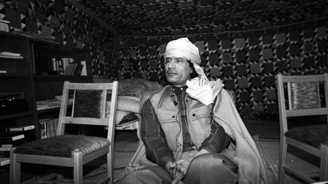File photo of Libyan leader Muammar Gaddafi during a news conference inside his Bedouin tent erected in the heavily fortified Bab El-Assaria barracks on the outskirts of Tripoli