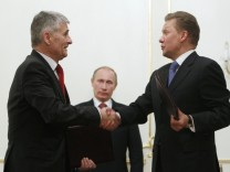 BASF AG Board Chairman Hambrecht shakes hands with Gazprom Chief Executive Miller during their meeting at Novo-Ogaryovo residence outside Moscow