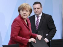 German Chancellor Merkel and Baden-Wuerttemberg's state premier Mappus arrive for a news conference after a meeting in the Chancellery in Berlin