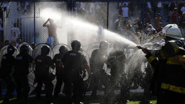 Argentine police hose down supporters of San Lorenzo de Almagro during clashes in Buenos Aires