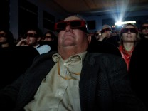 People watch a 3D movie at the 67th Venice Film Festival