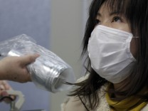 Imai, who was evacuated from Minamisoma in Fukushima, undergoes a test for signs of nuclear radiation at a health centre in Yonezawa, northern Japan