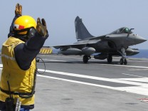 A Rafale fighter jet returns from a mission on the flight deck of France's flagship Charles de Gaulle aircraft carrier