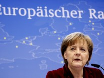 Germany's Chancellor Merkel holds a news conference at the end of a two-day European Union leaders summit in Brussels
