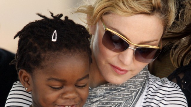 File photo of Madonna sitting with her adopted Malawian child Mercy James during a bricklaying ceremony at the site of her Raising Malawi Girls Academy