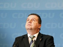 Mappus top candidate of CDU in the Baden-Wuerttemberg state election attends a news conference after party meeting in Berlin