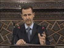 Video grab of Syrian President Bashar Al-Assad addressing the parliament in Damascus